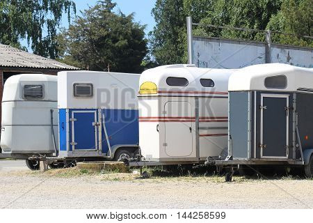 Trailers for horse transportation parked near racetrack