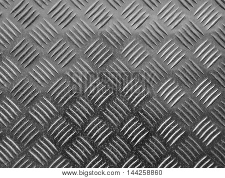 Grey steel diamond plate useful as a background in black and white