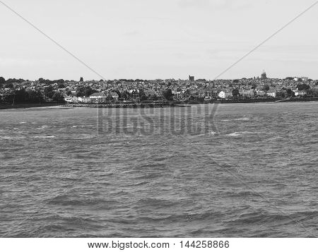 View of Birkenhead skyline across the Mersey river in Liverpool UK in black and white