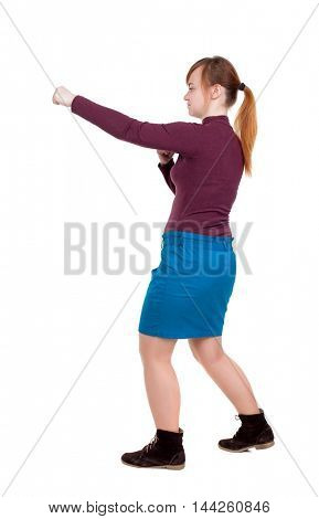 skinny woman funny fights waving his arms and legs. Girl with red hair tied in a pigtail boxing.