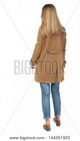 back view of standing young beautiful woman. blonde in a brown cloak, standing and looking forward.