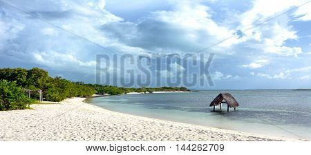 CAYO SANTA MARIA CUBA - JULY 24 2016: Beach chairs and cabanas at the Hotel Melia Buenavista. Set in a biosphere and surrounded by three beaches.