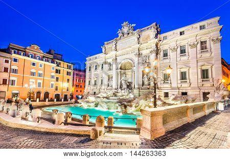 Rome Italy. Stunningly ornate Trevi Fountain and Palazzo Poli (1762) illuminated at night in the heart of Roma.