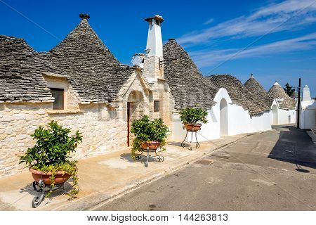 Alberobello Italy Puglia. Unique Trulli houses with conical roofs. Trullo trulli a traditional Apulian dry stone hut with a conical roof.