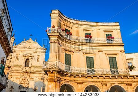Martina Franca Puglia in Italy. Piazza Plebiscito and Basilica di San Martino landmark of Brindis region in Apulia Italia.