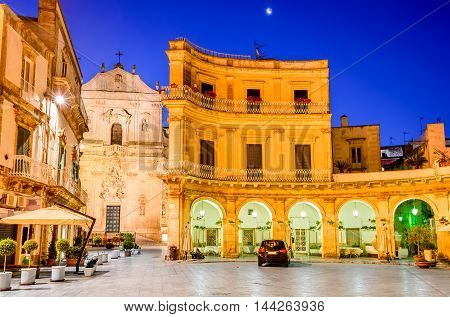 Martina Franca Puglia in Italy. Piazza Plebiscito and Basilica di San Martino at twilight.