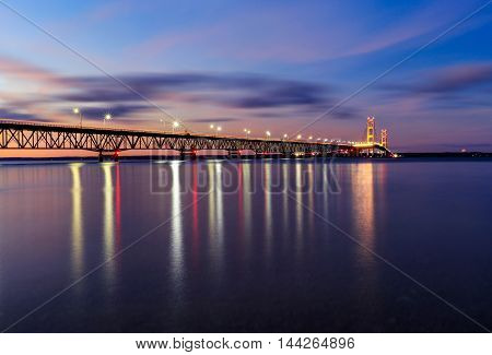 The Mackinac Bridge over the Straits of Mackinac at dusk connecting the upper and lower peninsulas of Michigan USA