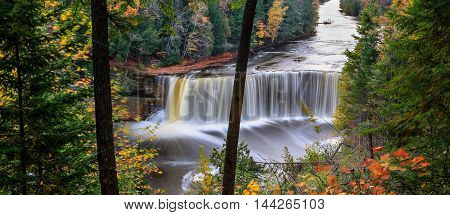 A very picturesque waterfall in motion blur Tahquamenon Falls in autumn Michigan's Upper Peninsula USA