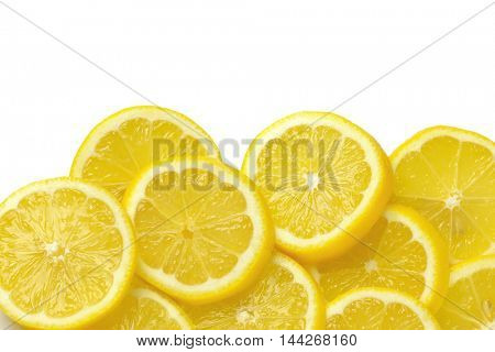 heap of fresh lemon slices on white background
