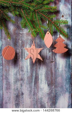 Christmas decoration of fir branches and toys on gray door