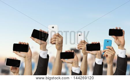 Crowd of people with phone in hands . Mixed media