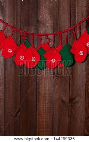 Christmas decoration socks for presents on brown door