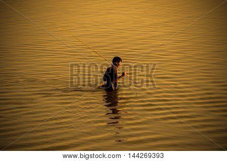Mandalay Myanmar Dec 14 2015 : fresh water fisherman in golden lake before sunset