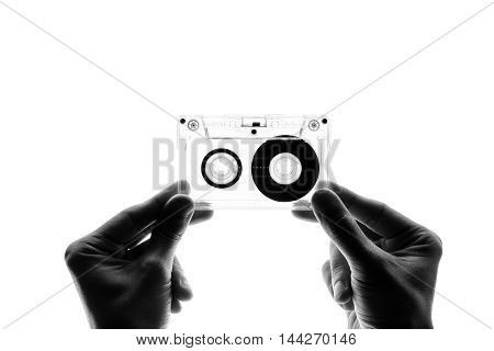 male hands holding a cassette tape, isolated, black and white