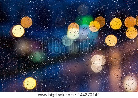 the night street through wet window, bokeh