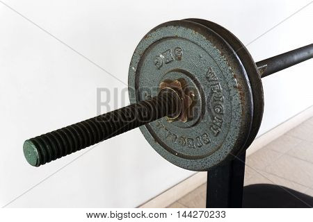 old steel dumbbell for fitness with white background