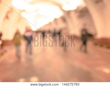 City commuters in subway. Unrecognizable humans moving through a subway tunnel. Blurred background texture for blog, websites, editorial use , etc.