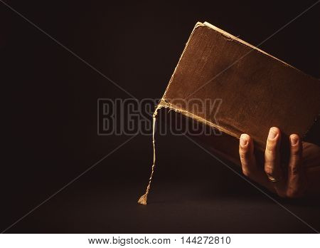 Male Hand Holding A Book