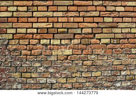 The old dilapidated wall of baked bricks.