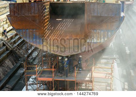 CAPE TOWN, SOUTH AFRICA - FEB 22, 2013: Unidentified workers work on the ship in Cape Town, South Africa. Cape town is the most popular international touristic destination in Africa