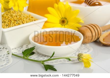 The Bowl Of Honey,  Bowl With  Pollen  And Yellow Flower Isolated On White