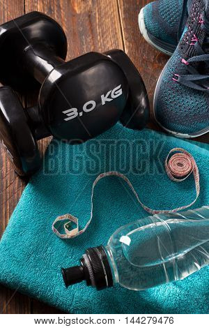 fitness concept with dumbell and fresh water