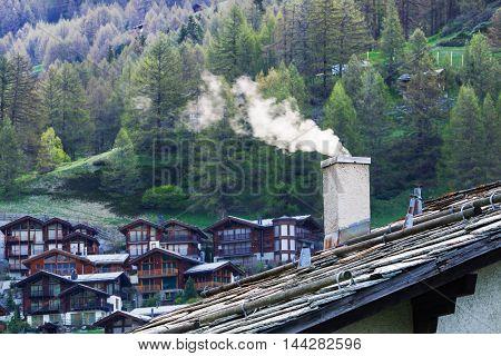 Smoke Raising From Chimney