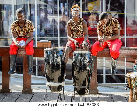 CAPE TOWN, SOUTH AFRICA - FEB 22, 2013: Unidentified musicians play the drums in the port of Cape Town, South Africa. Cape town is the most popular international touristic destination in Africa