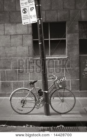 Bicycle Chained To Pole