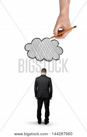 Back view of a businessman with bowed head standing and a big hand above that draws a cloud isolated on white background. Problems and troubles at work. Business staff.