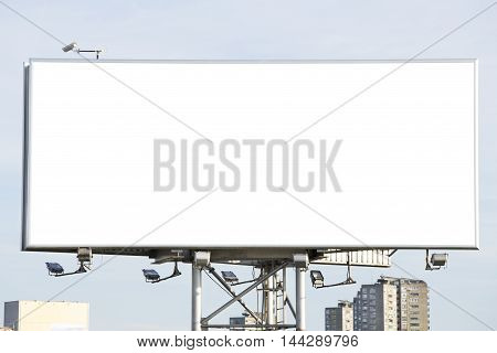 The blank billboard over a blue sky