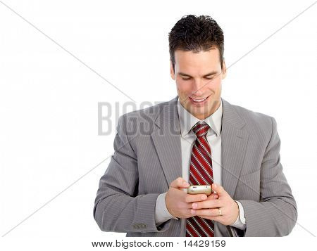 Young  smiling businessman with a cellular. Isolated over white background