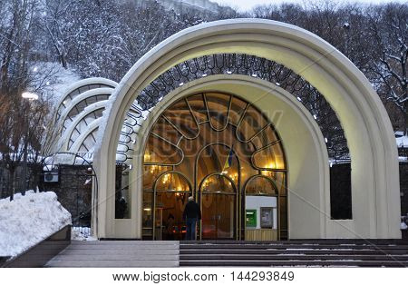 Entrance to Kiev Funicular. Winter. Building and trees are powdered with snow.