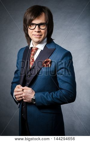 Long-haired Brunette Handsome Man In Blue Suit With Red Tie And