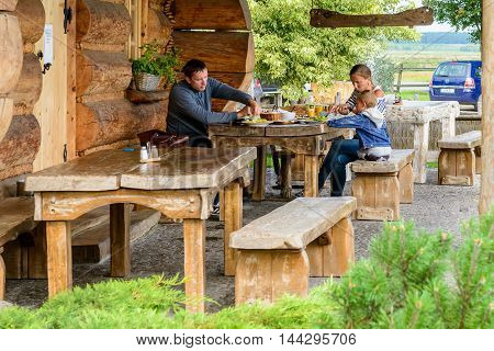 HORBOW, POLAND - AUGUST 17, 2014: Unidentified people eat at the Pajero Hotel in Horbow, Poland. Pajero hotel is located on the International road E-30, 20 km from the Belorussian Frontier
