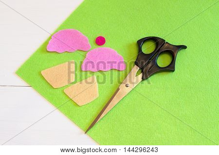 Cut out felt details for cupcake toy, scissors. Easy kids DIY project. Sewing for beginners. Step. Sewing set for felt cupcake