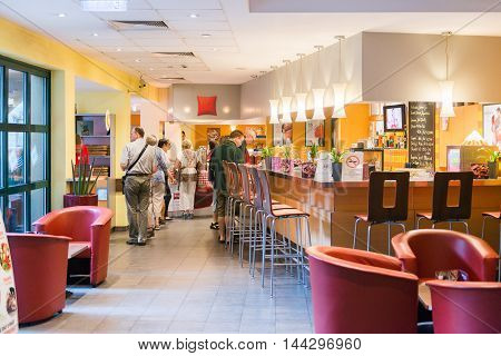 BUDAPEST, HUNGARY - AUGUST 18, 2014: Dining room in the Ibis hotel on the Heroes Square in Budapest, Hungary. ibis is an international hotel company, owned by Accor hotels.