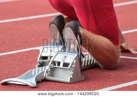 KAPFENBERG, AUSTRIA - AUGUST 8, 2015: An athlete prepares for the national track and field championship.