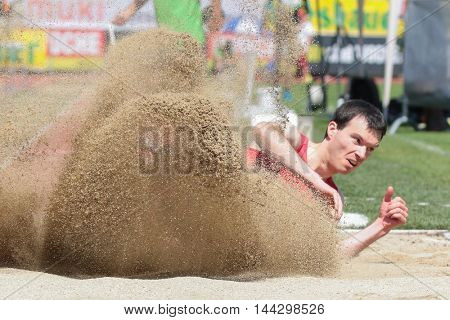 KAPFENBERG, AUSTRIA - AUGUST 9, 2015: Roman Schmied (#234 Austria) participates in the national track and field championship.