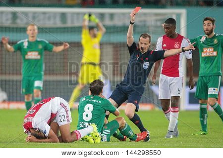 VIENNA, AUSTRIA - JULY 29, 2015: Referee William Collum shows the red card to Stefan Schwab (SK Rapid) in an UEFA Champions League qualification game.