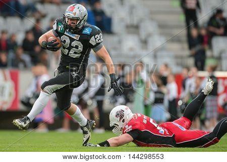 INNSBRUCK, AUSTRIA - MAY 2, 2015: LB Kerim Homri (#51 Lions) tackles RB Fabien-Andre Gaertner (#22 Raiders) in a game of the Big SIx Football League.