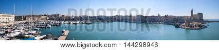 Trani Italy - May 22 2016: Panoramic the port and the beautiful church of the town of Trani in Apulia