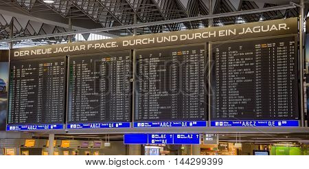 FRANKFURT AM MAIN GERMANY - JUNE 30 2016: Departures board in international Frankfurt Airport the busiest airport in Germany. In 2012 Frankfurt handled 57.5 million passengers.