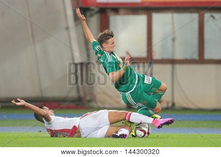VIENNA, AUSTRIA - JULY 29, 2015: Anwar El Ghazi (Ajax) and Stefan Stangl (SK Rapid) fight for the ball in an UEFA Champions League qualification game.