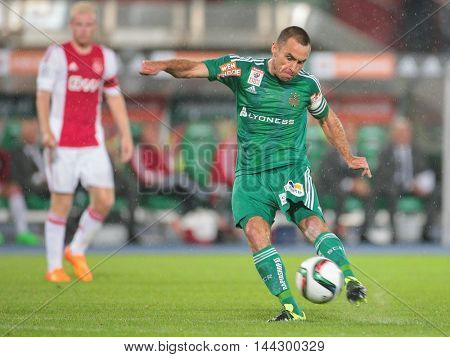 VIENNA, AUSTRIA - JULY 29, 2015: Steffen Hofmann (SK Rapid) kicks the ball in an UEFA Champions League qualification game.