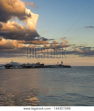 Seascape with old ships and a lighthouse Stock photo