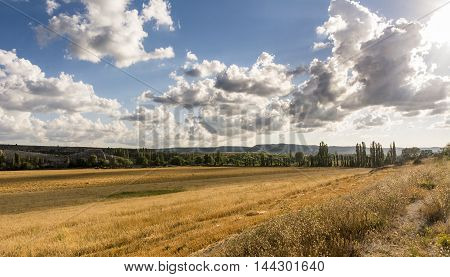 Landscape with highland valley with yellow grass. Crimea