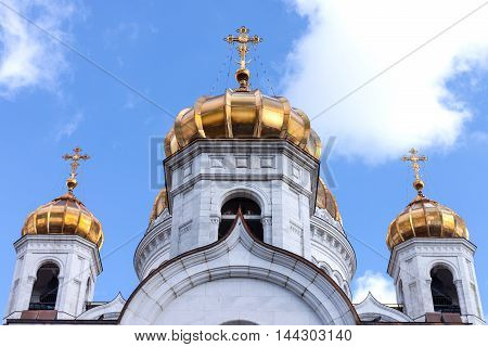 Gold domes of the Christian temple in Moscow