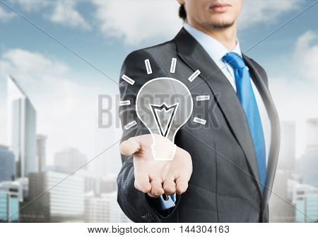 close-up look at businessman holding creativity icon