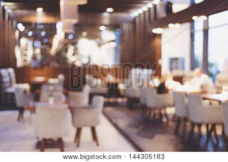 Blur coffee shop or cafe restaurant with abstract bokeh light image background.